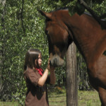 Child practising horse whispering